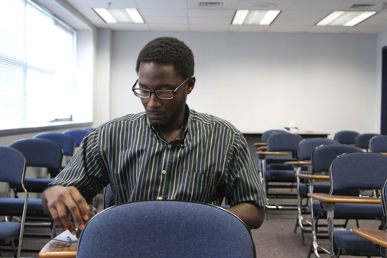 Shaquan Bagby, a Philadelphia, Pa., native looking to join the Army Reserves, prepares for an interview between evaluation stages while at the Military Entrance Processing Station on Joint Base McGuire-Dix-Lakehurst, N.J., Oct. 7, 2014. (U.S. Army photo by Sgt. Richard W. Hoppe/Released)