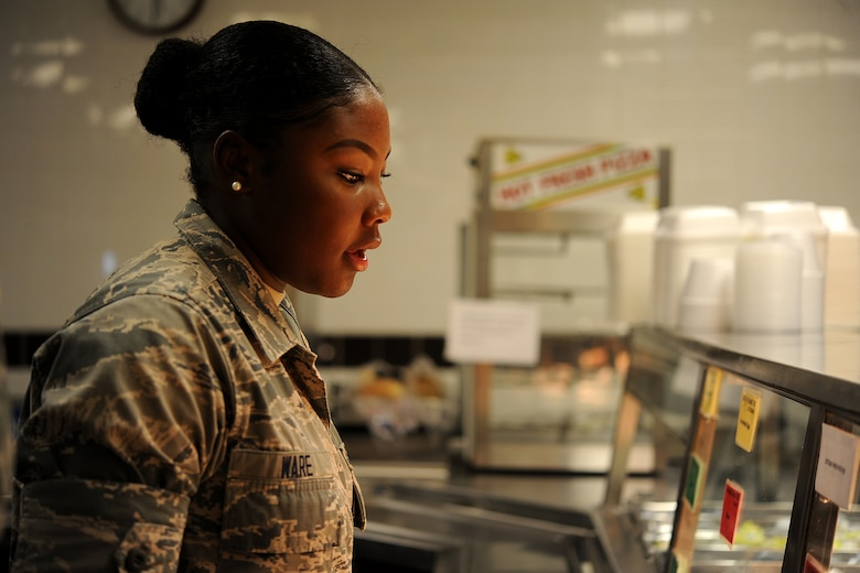 GOODFELLOW AIR FORCE BASE, Texas – Airman Jesyka Ware, 315th Training Squadron student, asks for food during breakfast at the Cressman Dining Hall Sept. 17. After breakfast, Ware and the other students form up outside the dining facility before marching to class. (U.S. Air Force photo/ Airman 1st Class Devin Boyer)