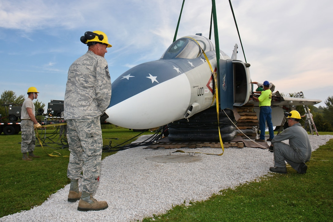 Members of the Wisconsin Air National Guard's 115th Fighter Wing Crash Damage or Disabled Aircraft Recovery team, reconstruct an F-4S Phantom static display on the grounds of Truax-Longmire Veterans of Foreign Wars Post 8483 in Madison, Wis., Sept. 20, 2014. The eight airmen representing the 115 FW CDDAR team were able to complete critical training requirements by removing and relocating the aircraft to Madison from its previous home at Camp Atterbury, Ind. (Air National Guard Photo by Master Sgt. Paul Gorman)