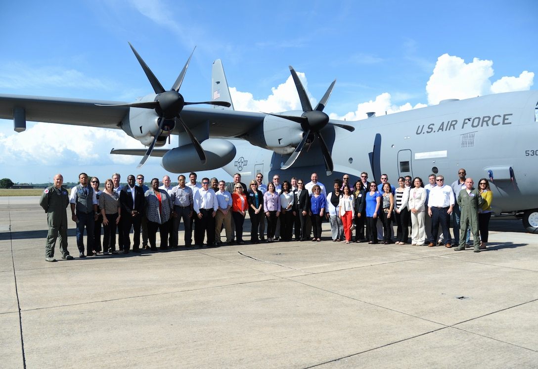 The Leadership Gulf Coast class poses for a group photo in front of a C-130J aircraft Oct. 8, 2014, during a visit to Keesler Air Force Base, Miss.  The visit also included a windshield tour of the base and a 403rd Wing briefing.  (U.S. Air Force photo by Kemberly Groue)