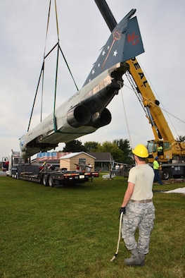 Staff Sgt. Tracy Hermanson, 115th Fighter Wing Crash Damage or Disabled Aircraft Recovery team member, guides the fusalage of an F-4S Phantom aircraft as it's relocated for display on the grounds of Truax-Longmire Veterans of Foreign Wars Post 8483 in Madison, Wis., Sept. 20, 2014. The eight airmen representing the 115 FW CDDAR team were able to complete critical training requirements by removing and relocating the aircraft to Madison from its previous home at Camp Atterbury, Ind. (Air National Guard Photo by Master Sgt. Paul Gorman)