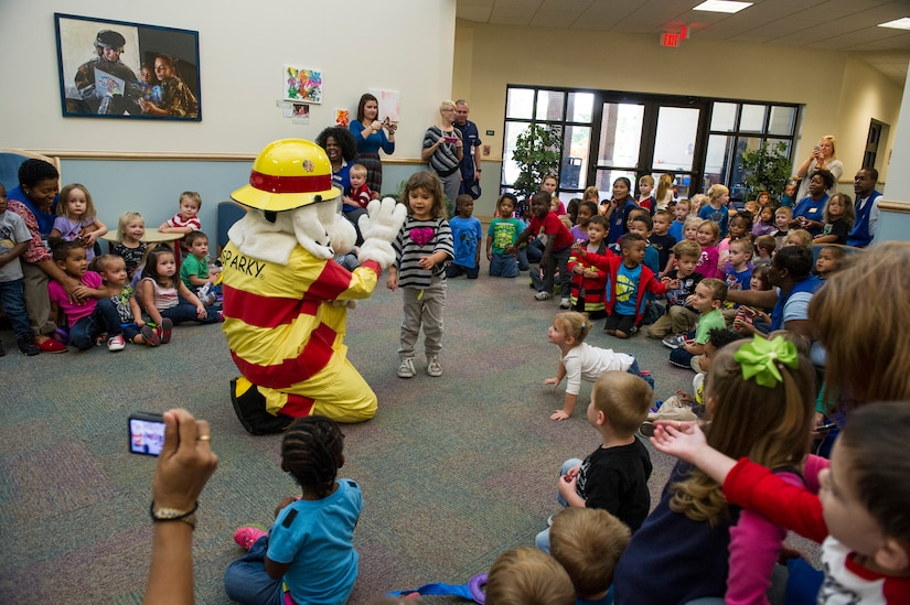 Sparky the fire dog visits children at the Brig. Gen. Thomas R. Mikolajcik Child Development Center, Oct. 6, 2014, on Joint Base Charleston, S.C. Fire prevention Week was Oct. 5 through 11, and the JB Charleston Fire Department hosted several events around the Air Base and Weapons Station. Fire prevention week was established in 1925 by President Calvin Coolidge when he became aware that close to 15,000 American citizens had been killed in fires the previous year. (U.S. Air Force photo/Airman 1st Class Clayton Cupit)