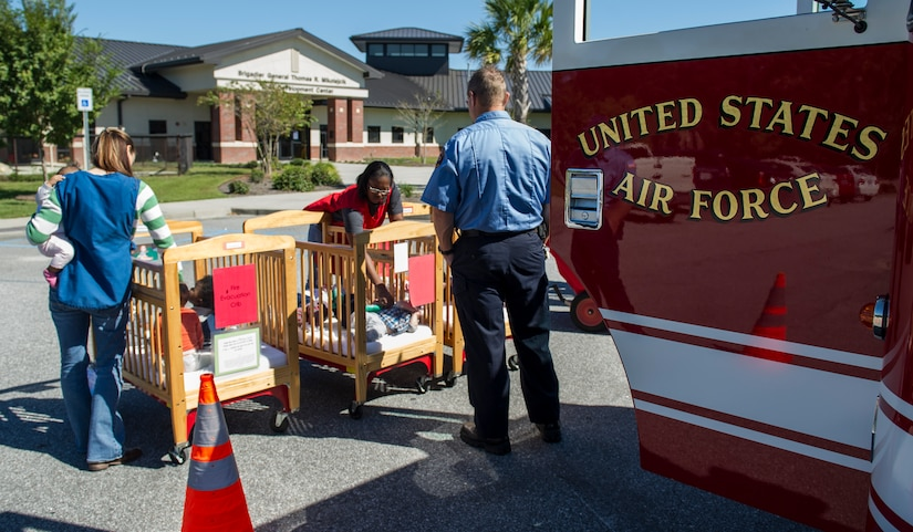 The Joint Base Charleston Fire Department visits the Brig. Gen. Thomas R. Mikolajcik Child Development Center, Oct. 6, 2014, on JB Charleston, S.C. Fire prevention Week was Oct. 5 through 11, and the JB Charleston Fire Department hosted several events around the Air Base and Weapons Station. Fire prevention week was established in 1925 by President Calvin Coolidge when he became aware that close to 15,000 American citizens had been killed in fires the previous year. (U.S. Air Force photo/Airman 1st Class Clayton Cupit)