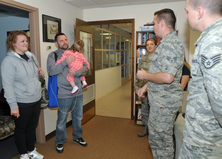 The 109th Airlift Wing's First Six Council donated $500 to the LeClaire family Oct. 5, 2014. Their 22-month-old daughter, Sophia, has cerebral palsy. The council raised the money during the Wing's Family Day with a dunk booth, and the donation will go toward Sophia's medical expenses. (U.S. Air National Guard photo by Tech. Sgt. Catharine Schmidt/Released)