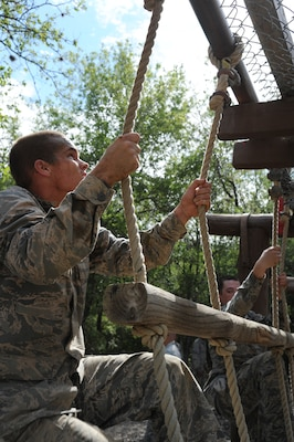 Basic military trainees climb up rope-and-wood ladders as part of the basic military training obstacle course at Joint Base San Antonio-Lackland, Sept. 24, 2014. The trainees completed the last run of course before its permanent closure the same day. A new course, called the Leadership Reaction Course, was added to basic expeditionary Airmen's training, also known as BEAST week, at JBSA-Lackland Medina Annex and became fully operational Sept. 29.  (U.S. Air Force photo by Senior Airman Krystal Jeffers/Released)