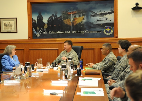 Hollister Petraeus, the Servicemember Affairs Consumer Financial Protection Bureau assistant director, receives a tour of Joint Base San Antonio-Randolph hosted by Brig. Gen. Robert D. LaBrutta, the 502nd Air Base Wing and JBSA commander, Oct. 2.  The tour gave both the CFPB and military members the opportunity to share challenges servicemembers face in maintain and financial readiness of the Armed Forces and explore additional federal resources available to assist. (U.S. Air Force photo/Melissa Peterson)