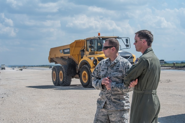 Capt. Erich Kramer, 820th Rapid Engineers Deployable Heavy Operational Repair Squadron Engineers design engineer, and Lt. Col. Matthew Borgos, 560th Flying Training Squadron instructor pilot, view construction progress Sept. 30, 2014, at the Seguin Auxiliary Air Field, Texas. More than 73,000 tons of gravel have been used to lay the base course of the runway. (U.S. Air Force photo by Airman 1st Class Stormy Archer/Released)