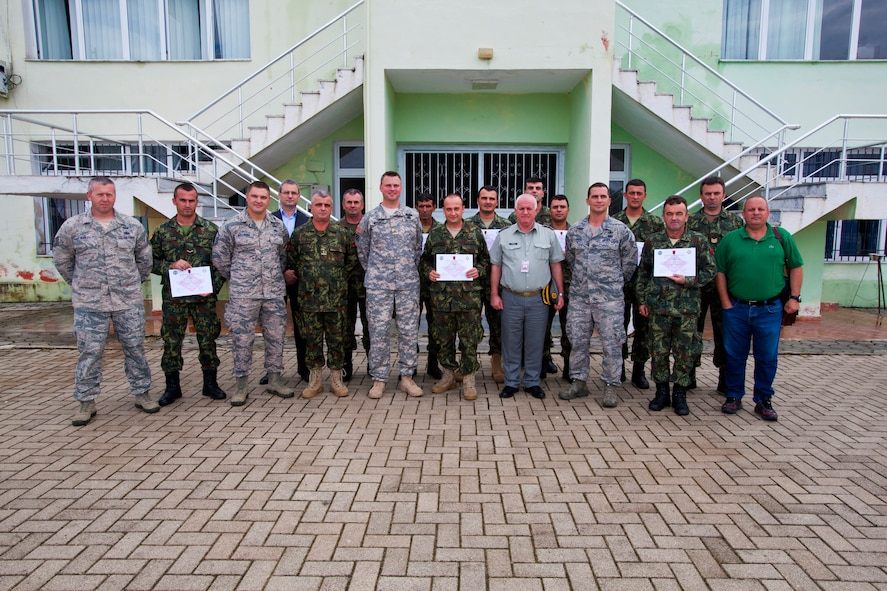 Albanian Army officers and explosive ordnance disposal Airmen from the 177th Fighter Wing, New Jersey Air National Guard, along with Albanian Army EOD soldiers pose for a group photo at Peze Helmes, Republic of Albania, Sept. 26, 2014. In September 2014, the 177th EOD team trained Albanian Army EOD soldiers to become level 1 EOD trainers. New Jersey National Guard Airmen and Soldiers have been training their Albanian counterparts for more than 20 years as part of the State Partnership Program between the state of New Jersey and the Republic of Albania. (U.S. Air National Guard photo by Master Sgt. Mark C. Olsen /Released)