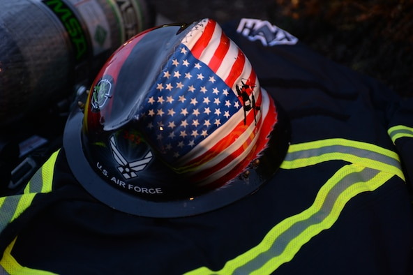 A firefighter's helmet rests on protective gear before the 9/11 memorial run at Spangdahlem Air Base, Germany, Sept. 11, 2014. Flags at federal installations will be flown at half-staff Oct. 12, 2014, in observance of National Fallen Firefighters Memorial Service. (U.S. Air Force photo by Staff Sgt. Joe W. McFadden/Released)