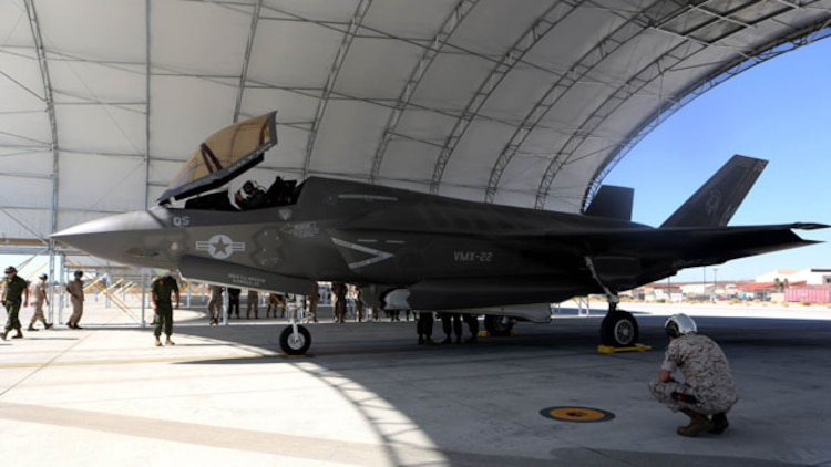 A F-35B Lightning II with Marine Operational and Test Evaluation Squadron 22 sits under a canopy while Marines conduct post flight checks aboard Edwards Air Force Base, Calif., Oct. 9. The F-35 Lightning II is scheduled to replace several Marine aircraft in the future.