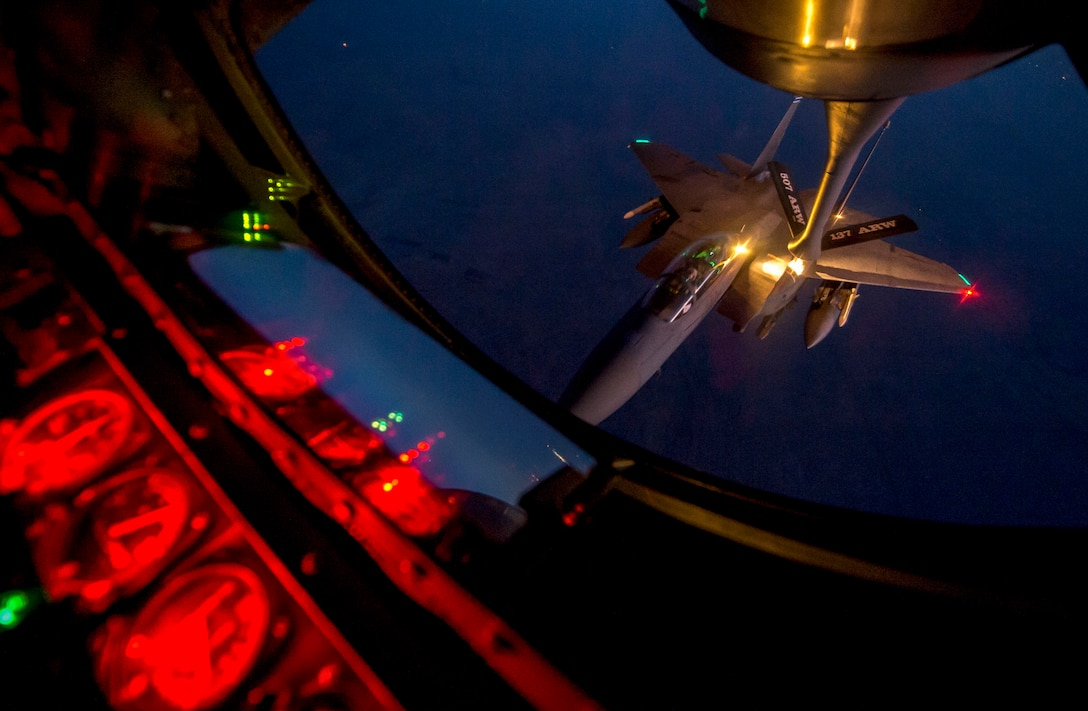 An F-15E Strike Eagle receives fuel from a KC-135 Stratotanker Sept. 23, 2014, over northern Iraq after conducting airstrikes in Syria. These aircraft were part of a large coalition strike package that was the first to strike Islamic State of Iraq and the Levant targets in Syria. (U.S. Air Force photo/Senior Airman Matthew Bruch)