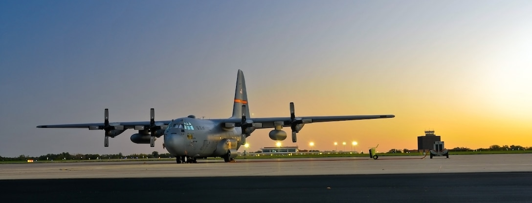 A 182nd Airlift Wing C-130 Hercules rests on the flightline at sunrise Oct. 8, 2014, in Peoria, Ill. The Illinois Air National Guard unit has been flying C-130s since 1995. (U.S. Air National Guard photo/Staff Sgt. Lealan Buehrer)