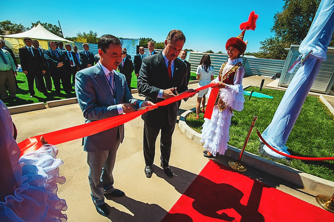 Defense Threat Reduction Agency Director Ken Meyers (center) assists with cutting the ribbon signifying the opening the 7,535 square foot Bio-Safety Level-3 facility addition in Otar, Kazakhstan Aug. 27. Huntsville Center provides construction management oversight and engineering support in designing and building the BSL-3 facility as well as an 86,111 square foot Central Reference Laboratory in Almaty, Kazakhstan. DTRA supports cooperative agreements with host nations focused on bio-terror threats outside the continental U.S. by providing facilities and equipment to monitor and detect potential endemic threats. In addition to the two facilities in Kazakhstan, Huntsville Center also supports DTRA with a rehabilitation of existing facilities in Armenia, Kenya and a Central Public Health Laboratory and National Public Health Laboratory in Afghanistan.