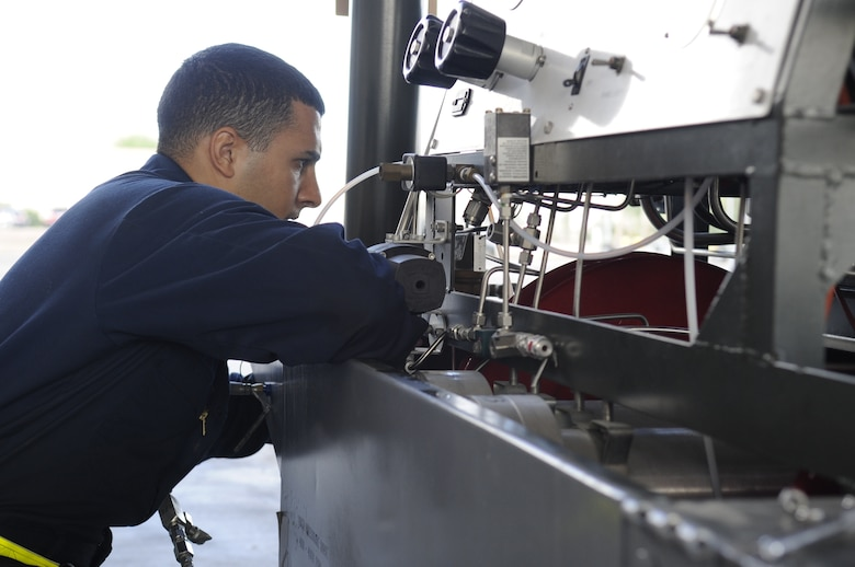 U.S. Air Force Airman 1st Class Jamal Miqbel, 355th Equipment Maintenance Squadron aerospace ground equipment journeyman, removes a panel from a self-generating nitrogen cart at Davis-Monthan Air Force Base, Ariz., Oct. 9, 2014. Miqbel removed the panel in order to replace a part that required a maintenance update. (U.S. Air Force photo by Airman 1st Class Betty R. Chevalier/Released)