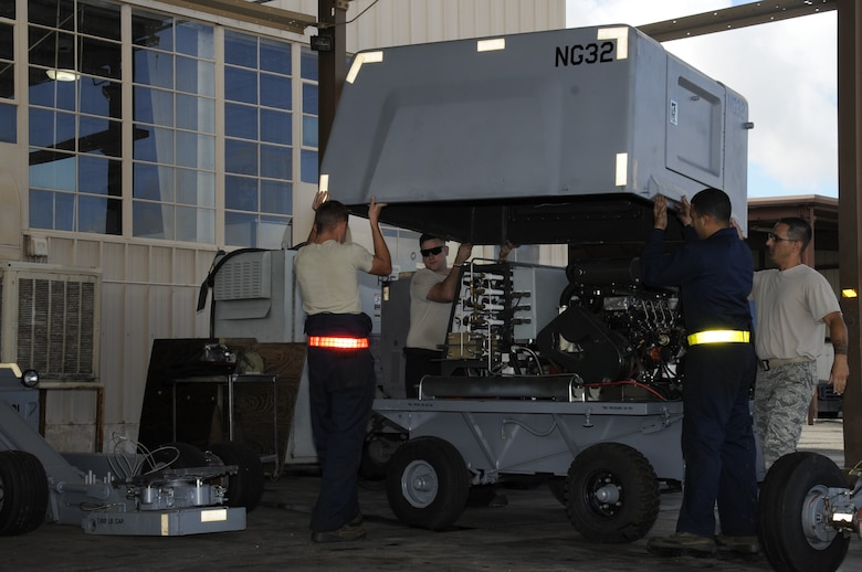 U.S. Air Force Airmen assigned to the 355th Equipment Maintenance Squadron aerospace ground equipment flight, remove the cover to a self-generating nitrogen cart at Davis-Monthan Air Force Base, Ariz., Oct. 9, 2014. The AGE flight is responsible for maintaining the equipment that supplies electric, hydraulic and pneumatic power necessary to perform maintenance on the given aircraft. (U.S. Air Force photo by Airman 1st Class Betty R. Chevalier/Released)
