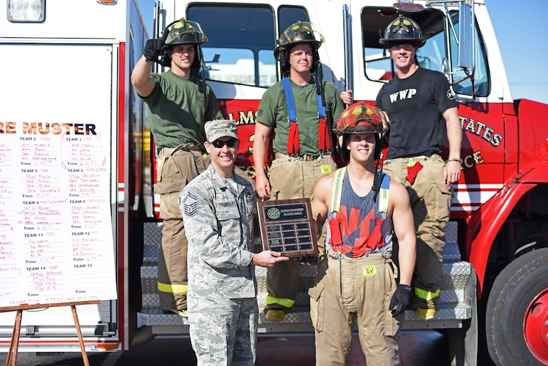The winning team of Malmstrom Air Force Base's fourth annual Fire Prevention Week fire muster pose for a photograph after recovering from the challenge Oct. 10. Airmen with the 341st Security Forces Group Tactical Response Force took first place with a winning time of six minutes and twenty one seconds. (U.S. Air Force photo/Airman 1st Class Collin Schmidt)