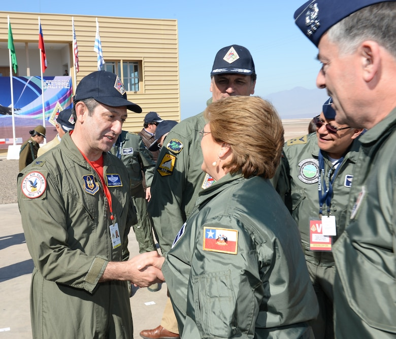 U.S. Air Force Col. Mike Torrealday, Reserve Advisor to the 12th Air Force (Air Forces Southern) Commander, greets President Michelle Bachelet of Chile during her visit to Salitre 2014, Oct. 10. Salitre is a Chilean-led exercise where the U.S., Chile, Brazil, Argentina and Uruguay, focus on increasing interoperability between allied nations. (Air National Guard photo by Senior Master Sgt. Miguel Arellano/released)