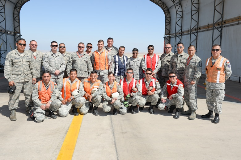 F-16 crew chiefs from the 149th Fighter Wing, Texas Air National Guard and the Chilean air force, work together during the State Partnership Program at Cerro Moreno Air Force Base, Chile, as part of a multi-national exercise, Salitre 2014, Oct. 10. Salitre is a Chilean-led exercise where the U.S., Chile, Brazil, Argentina and Uruguay, focus on increasing interoperability between allied nations. (Air National Guard photo by Senior Master Sgt. Miguel Arellano/released)