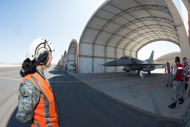 An F-16 crew chief from the Chilean air force prepares to taxi out an F-16 Fighting Falcon from the 149th Fighter Wing, Texas Air National Guard during the State Partnership Program at Cerro Moreno Air Force Base, Chile, as part of a multi-national exercise, Salitre 2014, Oct. 10. Salitre is a Chliean-led exercise event where the U.S. is participating as part of a larger coalition, combined team, focused on increasing interoperability. (Air National Guard photo by Senior Master Sgt. Elizabeth Gilbert/released)