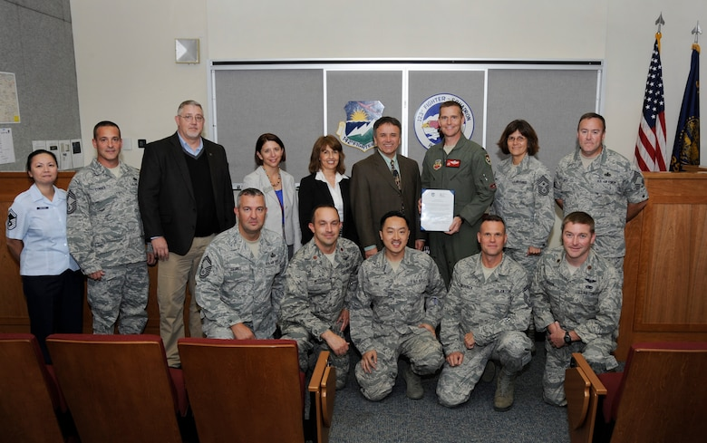 Staff members from Klamath Community College (KCC) and Airmen of the 142nd Fighter Wing join Col. Richard W. Wedan, 142nd Fighter Wing Commander, (third from right) and Dr. Roberto Gutierrez, President of Klamath Community College, (fourth from right) for a group photograph during the conclusion of the signing ceremony between the college and the 142nd Fighter Wing, Oct. 7, Portland Air National Guard Base, Ore. A Memorandum of Understanding agreement will allow KCC to help Airmen complete their Community College of the Air Force degree in a more effective manner. (U.S. Air National Guard photo by Tech. Sgt. John Hughel, 142nd Fighter Wing Public Affairs/Released)