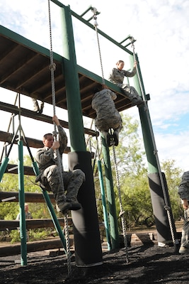 Basic military trainees slide down 14 feet with a rope as part of the basic military training obstacle course Sept. 24, 2014 at Joint Base San Antonio-Lackland. The trainees completed the last run of mile-and-a-half long course before its permanent closure the same day.  A new course, called the Leadership Reaction Course, was integrated into the Creating Leaders, Airmen, and Warriors mission. The CLAW is part of the basic expeditionary Airmen's training, also known as BEAST week, at JBSA-Lackland Medina Annex and became fully operational Sept. 29. (U.S. Air Force photo by Senior Airman Krystal Jeffers/Released)
