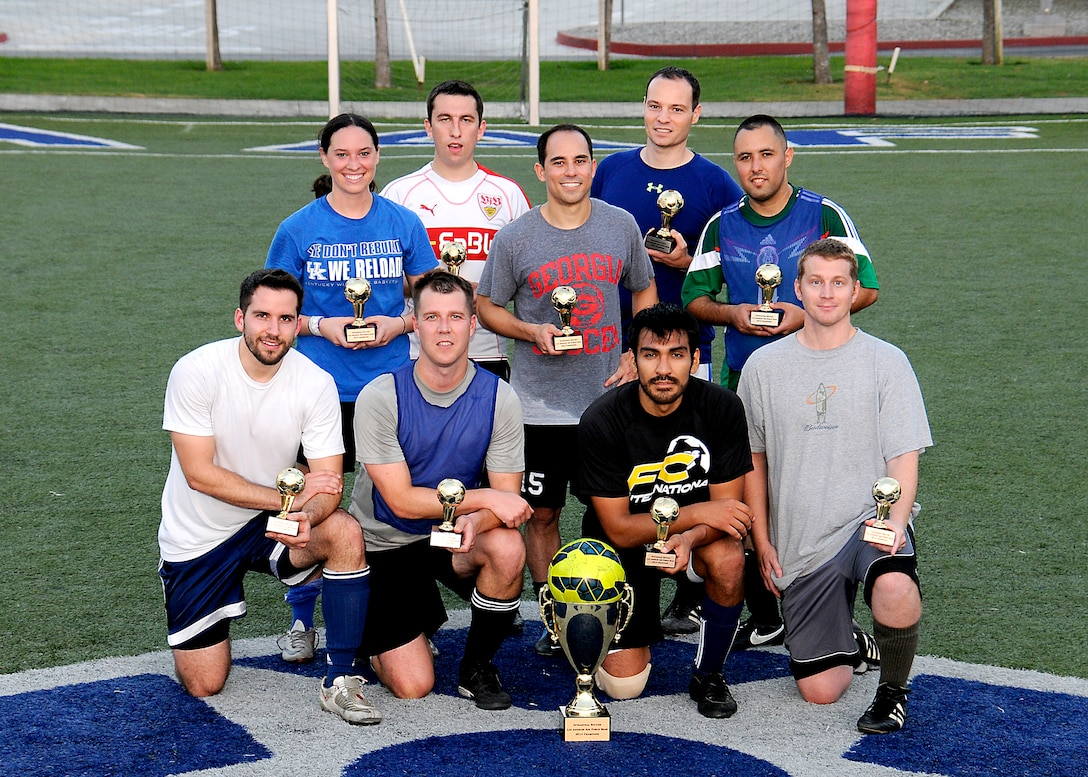 """Space and Missile System Center (SMC) Remote Sensing Systems Directorate (RS) team """"A"""" beat out SMC Launch and Range Systems Directorate (LR) in the Los Angeles Air Force Base soccer playoffs, Oct 8, 2014. LR took the first game 3 to 1 over RS but RS came back to force the playoff and won 2 to 1 over LR for the Championship win. Photo by Joe Juarez"""