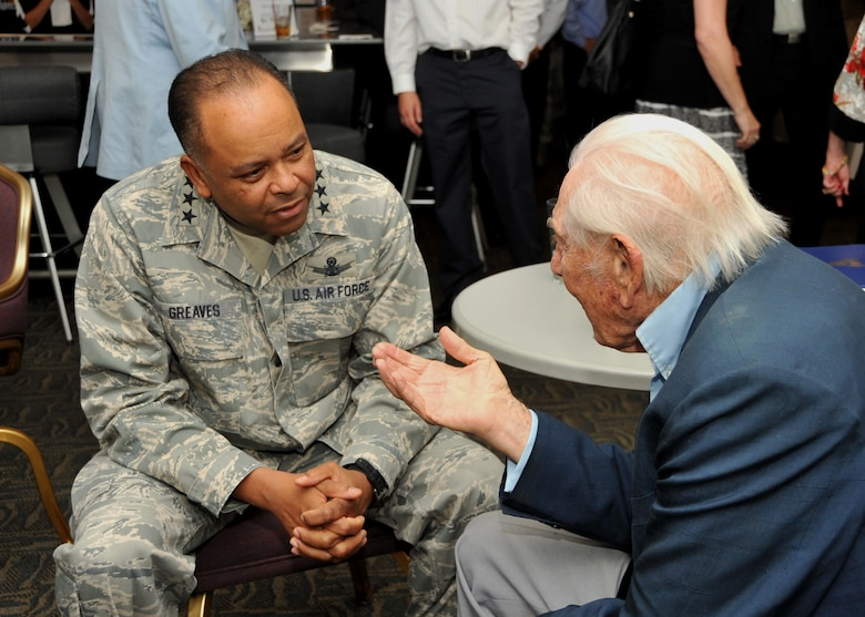 U.S. Air Force Lt. Gen. Sam Greaves, commander of the Space and Missile Systems Center chats with U.S Army Air Corps Lt. Col. (Ret.) Robert L. Hecker during a function hosted by the Air Force Association's Bernard Schriever Chapter 147 at Los Angeles Air Force Base on October 3, 2014.  Lt. Col. Hecker flew B-17s in thirty missions over Europe, earning five Air Medals and the Distinguished Flying Cross.  After the war, Hecker began writing for radio and television, and has since become a prolific screenwriter, playwright, and producer.  (U.S. Air Force photo by Sarah Corrice)