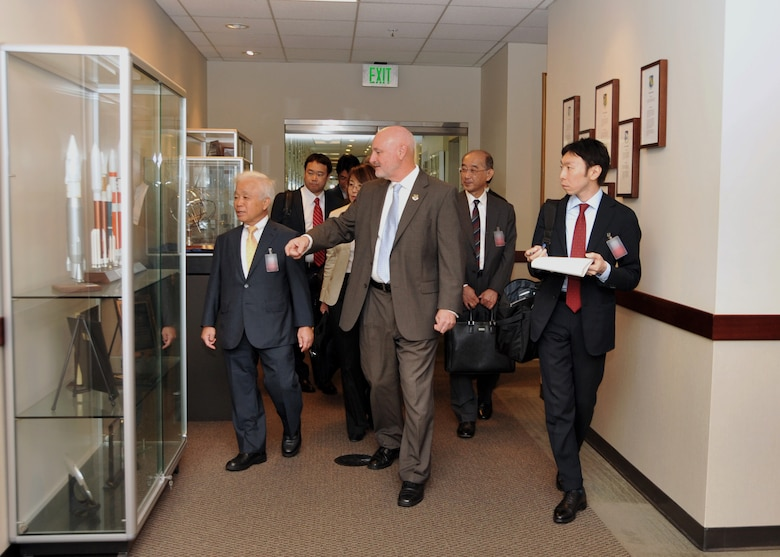 Mr. David Madden, Executive Director, Space and Missile Systems Center hosts Dr. Naoki Okumura, president of the Japanese Aerospace Exploration Agency, along with other members of a JAXA delegation during their visit to Los Angeles Air Force Base in El Segundo, Calif., on October 2, 2014. The JAXA delegation was treated to a tour of historic displays given by chief historian, Dr. Harry Waldron, and a briefing about SMC. (U.S. Air Force photo by Sarah Corrice)