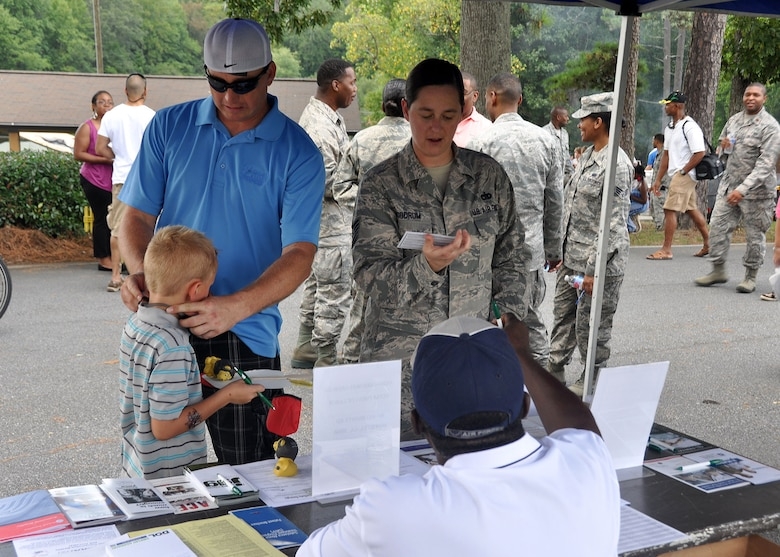 TSgt Chari Woodrum, 80th Aerial Port Squadron, navigates through Family Day  with her husband Michael and son Samuel  Sept. 6, 2014 at Dobbins Air Reserve Base, Ga. Family Day is an annual event celebrating the support family member gives Dobbins Airmen.