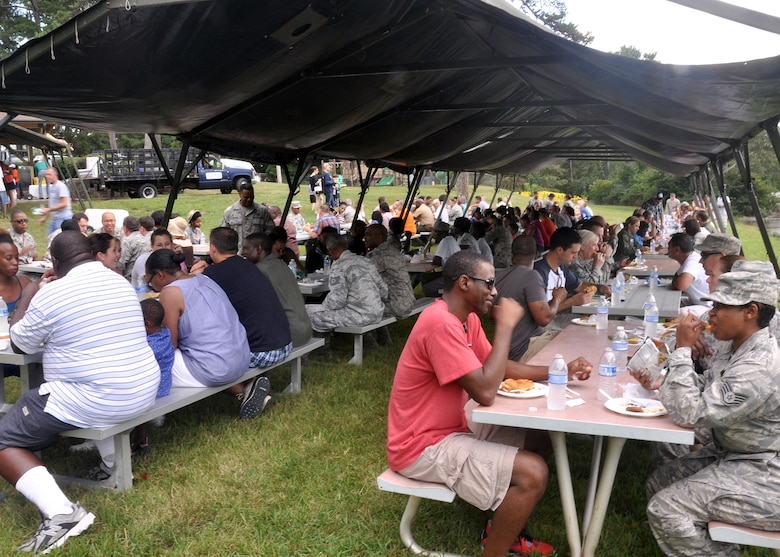 Reservist, families and friends take time to enjoy a picnic lunch at the 94th Airlift Wing Annual Family Day  Sept. 6, 2014 at Dobbins Air Reserve Base, Ga. Family Day is an opportunity for families to show their thanks and support to reserve members.