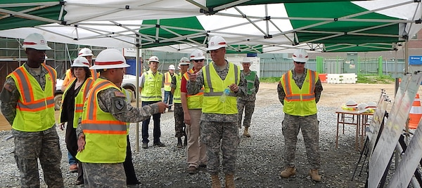Capt. Joseph Claros (foreground), project engineer at the Pyeongtaek resident office and ADOS Soldier gives a briefing to Lt. Gen. David D. Halverson, Commander, U.S. Army Installation Management Command and Assistant Chief of Staff for Installation Management.