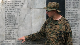 U.S. Navy Lt. Yonatan Warren explains the history of the Bataan Death March at the memorial wall during Amphibious Landing Exercise 15, Oct. 8, 2014. More then 100 Marines visited the memorial over two days to learn more about the events of World War II that occurred in the Philippines. PHIBLEX is an annual, bilateral training exercise conducted by members of the Armed Forces of the Philippines alongside U.S. Marine and Navy Forces focused on strengthening the partnership and relationships between the two nations across a range of military operations including disaster relief and complex expeditionary operations. Warren is the chaplain for Combat Logistics Battalion 31, 31st Marine Expeditionary Unit.