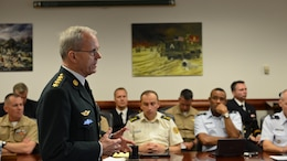 "Danish Gen. Knud Bartels, front left, Chairman of the North Atlantic Treaty Organization Military Committee, briefs a group of students attending the Marine Corps War College at Marine Corps Base Quantico, Virginia Oct. 3, 2014 during his tour of the United States. ""The greatest responsibility of the Alliance is to protect and defend our territories and our populations against attack, as set out in Article 5 of the Washington Treaty,"" said Bartels. ""Our Alliance remains an essential source of stability in this unpredictable world."""