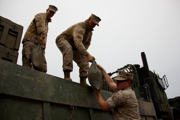 Marines with Combat Logistics Battalion 13 unload equipment from a truck to set up a humanitarian assistance and disaster relief village for San Francisco Fleet Week 2014, Oct. 10. During the course of fleet week, Marines have been demonstrating assets available for the Bay Area in response to a sudden crisis. The intent is to showcase amphibious nature, readiness and the ability to respond to disasters and highlight the role the Navy-Marine Corps team can play in assisting disaster victims.