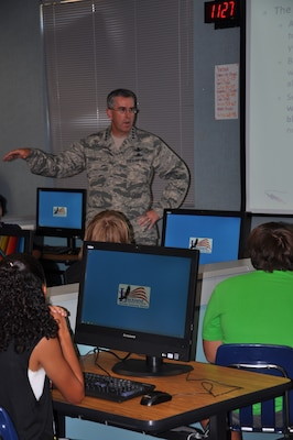 General John E. Hyten, Air Force Space Command commander, talks to Virginia Allred Stacey Junior/Senior High School students about the advantages of early exposure to advanced technology during a visit to Joint Base San Antonio - Lackland, Texas, Sept. 3. Members of 24th Air Force, who fall under the general's command, mentor CyberPatriot participants at Stacey annually as part of the national high school cyber defense competition. This year, more than 100 teams are participating from across the greater San Antonio area, include 24 middle schools. (U.S. Air Force photo/Christine D. Millette)