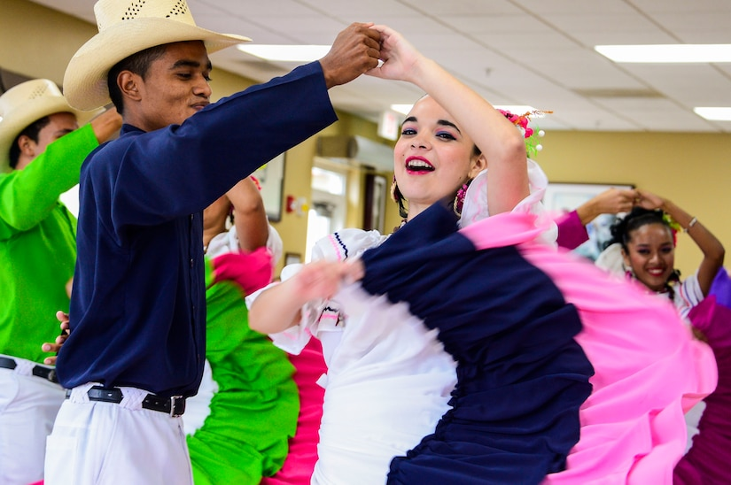 Folk dance performers from the Escuela Normal Centro América entertain the members of Joint Task Force-Bravo during Hispanic Heritage Month celebration at the dining facility on Soto Cano Air Base, Honduras, Oct. 9, 2014.  In celebration of Hispanic Heritage Month, JTF-B coordinated performances from the Honduran Navy Band stationed in Tegucigalpa,  the official folk dance group from the Escuela Normal Centro América, as well as a couple of performers  from the Dilcia Mejia Dance School. (U.S. Air Force Photo by Tech. Sgt. Heather Redman/Released)