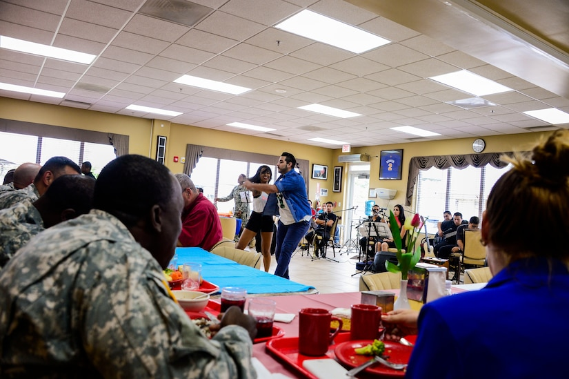 Performers from the Dilcia Mejia Dance School entertain the members of Joint Task Force-Bravo during Hispanic Heritage Month celebration at the dining facility on Soto Cano Air Base, Honduras, Oct. 9, 2014.  In celebration of Hispanic Heritage Month, JTF-B coordinated performances from the Honduran Navy Band stationed in Tegucigalpa,  the official folk dance group from the Escuela Normal Centro América, as well as a couple of performers  from the Dilcia Mejia Dance School. (U.S. Air Force Photo by Tech. Sgt. Heather Redman/Released)