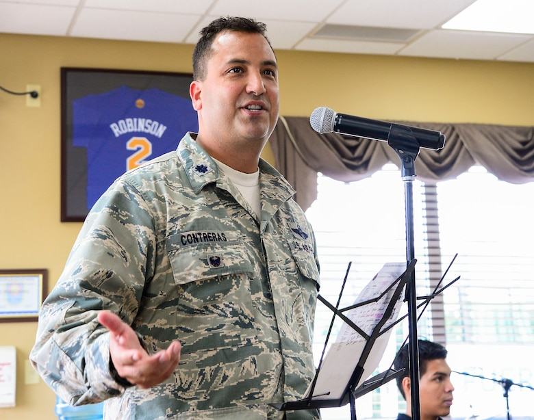 U.S. Air Force Lt. Col. Matthew Contreras, deputy commander of Joint Task Force-Bravo gives the key note speech celebrating Hispanic Heritage Month at the dining facility on Soto Cano Air Base, Honduras, Oct. 9, 2014.  In celebration of Hispanic Heritage Month, JTF-B coordinated performances from the Honduran Navy Band stationed in Tegucigalpa,  the official folk dance group from the Escuela Normal Centro América, as well as a couple of performers  from the Dilcia Mejia Dance School. (U.S. Air Force Photo by Tech. Sgt. Heather Redman/Released)