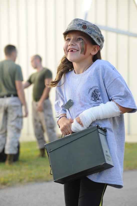 The daughter of  Maj. Billy Pope, 81st Communications Squadron commander, participates in the Marine obstacle course during Operation Hero Oct. 11, 2014, at Keesler Air Force Base, Miss.  The event was designed to help children better understand what happens when their parents deploy.  (U.S. Air Force photo by Kemberly Groue)