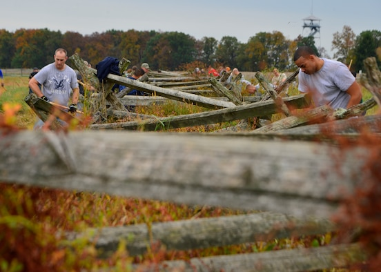 Team Dover volunteer Airmen work to clear and rebuild a 300 yard fence line Oct. 10, 2014, at Gettysburg National Military Park, Pa. More than 100 volunteer Airmen showed up to the event which was organized by the Dover Air Force Base First Sergeants Council. (U.S. Air Force photo/Airman 1st Class William Johnson)