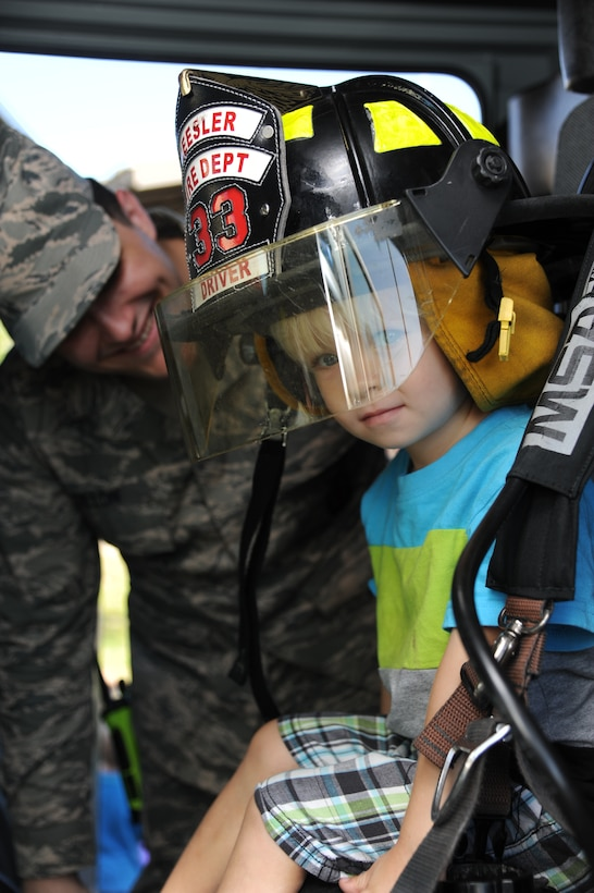 The son of Tech. Sgt. Sherman Dixon, 336th Training Squadron, tours the inside of a fire truck Oct. 7, 2014, at the child development center, Keesler Air Force Base, Miss., during a visit from the Keesler Fire Department for fire prevention week. Throughout fire prevention week the Keesler Fire Department conducted random fire drills, toured various facilities with Sparky the Fire Dog, passed out fire safety handouts and fire hats for children and provided stove and fire extinguisher demonstrations.  The week–long event ended with an open house at the fire station 10 a.m. to 2 p.m. Oct. 11.  (U.S. Air Force photo by Kemberly Groue)