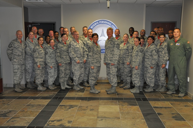 Chief Master Sgt. Craig Hall, 460th Space Wing command chief, stands among enlisted members at the Air Reserve Personnel Center Oct. 10, 2014, on Buckley Air Force Base, Colo. Hall was greeted by Chief Master Sgt. Ruthe Flores, ARPC command chief, then spoke to enlisted personnel in the center's lobby as to bid farewell, thank them for their service and let them know the impact they made on him. (U.S. Air Force photo/Tech. Sgt. Rob Hazelett)