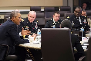 President Barack Obama meets with U.S. military leaders and representatives from 21 foreign nations to discuss strategy employed against Islamic State of Iraq and the Levant terrorists during a conference at Joint Base Andrews, Md., Oct 14, 2014. DoD photo by D. Myles Cullen