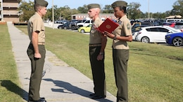 "Col. Matthew G. St. Clair, commanding officer, Ground Combat Element Integrated Task Force, presents 1st Lt. Benjamin Sheldon, platoon commander, Company A, GCEITF, with a Navy and Marine Corps Commendation Medal with combat ""V"" distinguishing device at the task force headquarters, Oct. 10, 2014. Sheldon was awarded for actions during a deployment to Afghanistan with 1st Battalion, 9th Marine Regiment, from September 2013 to May 2014. From October 2014 to July 2015, the GCEITF will conduct individual and collective level skills training in designated ground combat arms occupational specialties in order to facilitate the standards based assessment of the physical performance of Marines in a simulated operating environment performing specific ground combat arms tasks. (U.S. Marine Corps photo by Cpl. Paul S. Martinez/Released)"