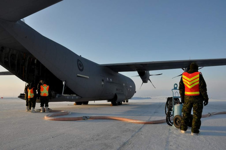 Royal Canadian Air Force maintainers prepare to fill a fuel bladder inside a C-130 Globemaster III aircraft for delivery to Canadian Forces Station Alert Sept. 30. The resupply of CFS Alert was part of Operation Boxtop, a bi-annual mission to resupply Canadian outposts to assist them in sustaining the harsh Arctic winters. (U.S. Air Force photo/Tech. Sgt. Jason Brumbaugh)