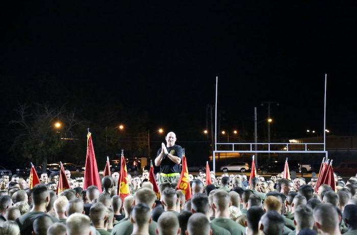 Commanding Officer, Marine Corps Detachment, Fort Leonard Wood, Missouri, Colonel Daniel E. Longwell talks to Marines after Detachment PT, Oct. 9, 2014.