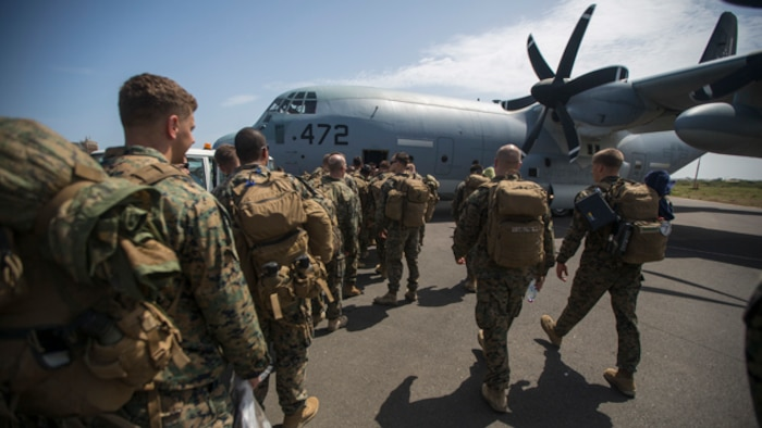 U.S. Marines and Sailors with Special-Purpose Marine Air-Ground Task Force - Crisis Response - Africa board a KC-130J Super Hercules to travel to Liberia from Dakar, Senegal, to support Operation United Assistance, Oct. 9, 2014. Operation United Assistance is part of a comprehensive U.S. Government effort, led by the U.S. Agency for International Development, to respond to and contain the outbreak of the Ebola virus in West Africa as quickly as possible. (U.S. Marine Corps photo by Lance Cpl. Andre Dakis/SPMAGTF Crisis Response - Africa Combat Camera/Released)