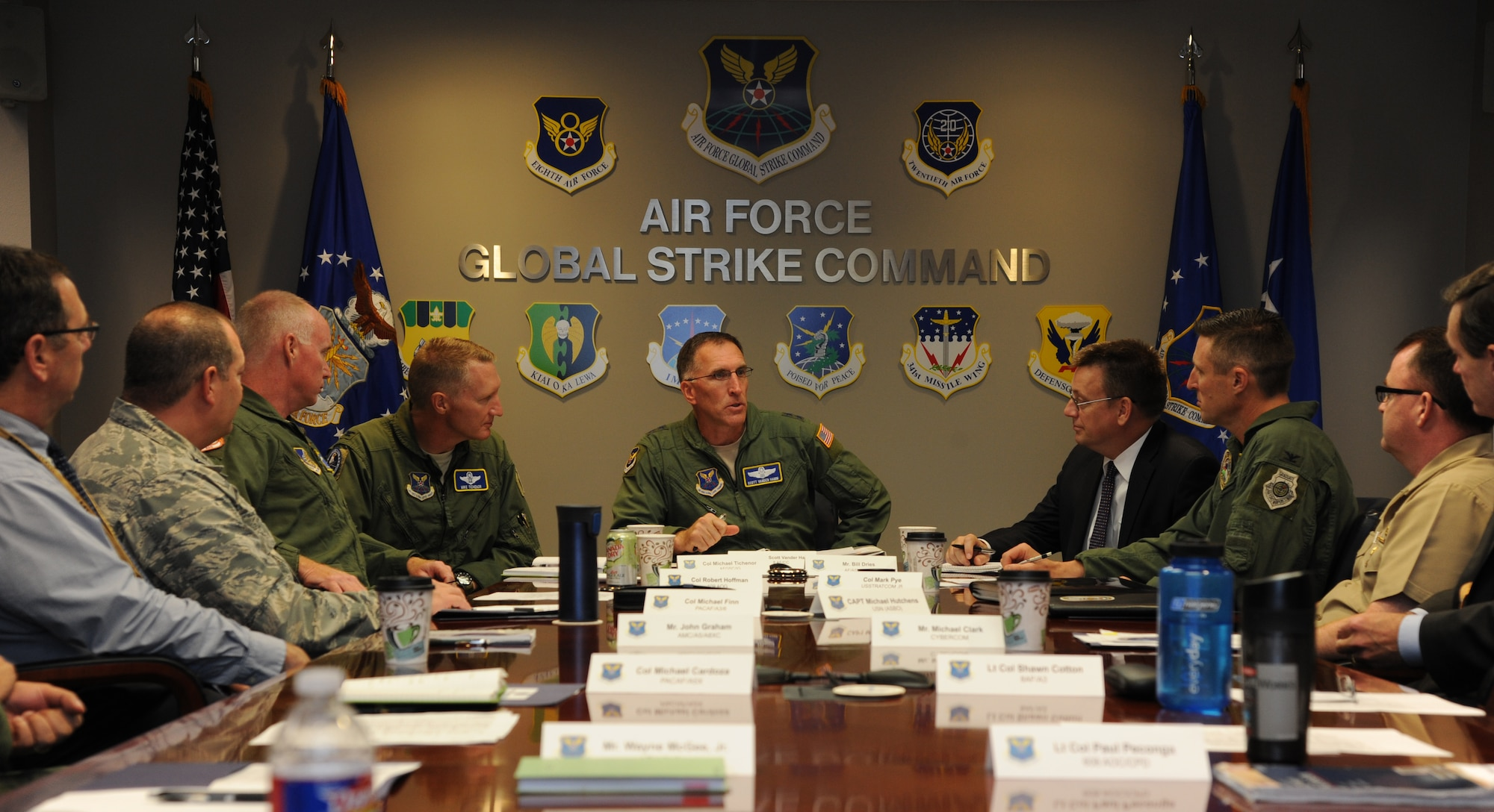 Maj. Gen. Scott Vander Hamm, center, and Col. Michael Tichenor, left of center, discuss expectations with the joint planning group Oct. 6, 2014, during the Global Strike Workshop at Barksdale Air Force Base, La. The workshop organizers crafted plans which integrated Air Force Global Strike Command assets into a joint environment, focusing on how to best utilize the total force in the most effective and efficient manner. Hamm is the 8th Air Force commander and Tichenor is the AFGSC inspector general. (U.S. Air Force photo/1st Lt. Christopher Mesnard)