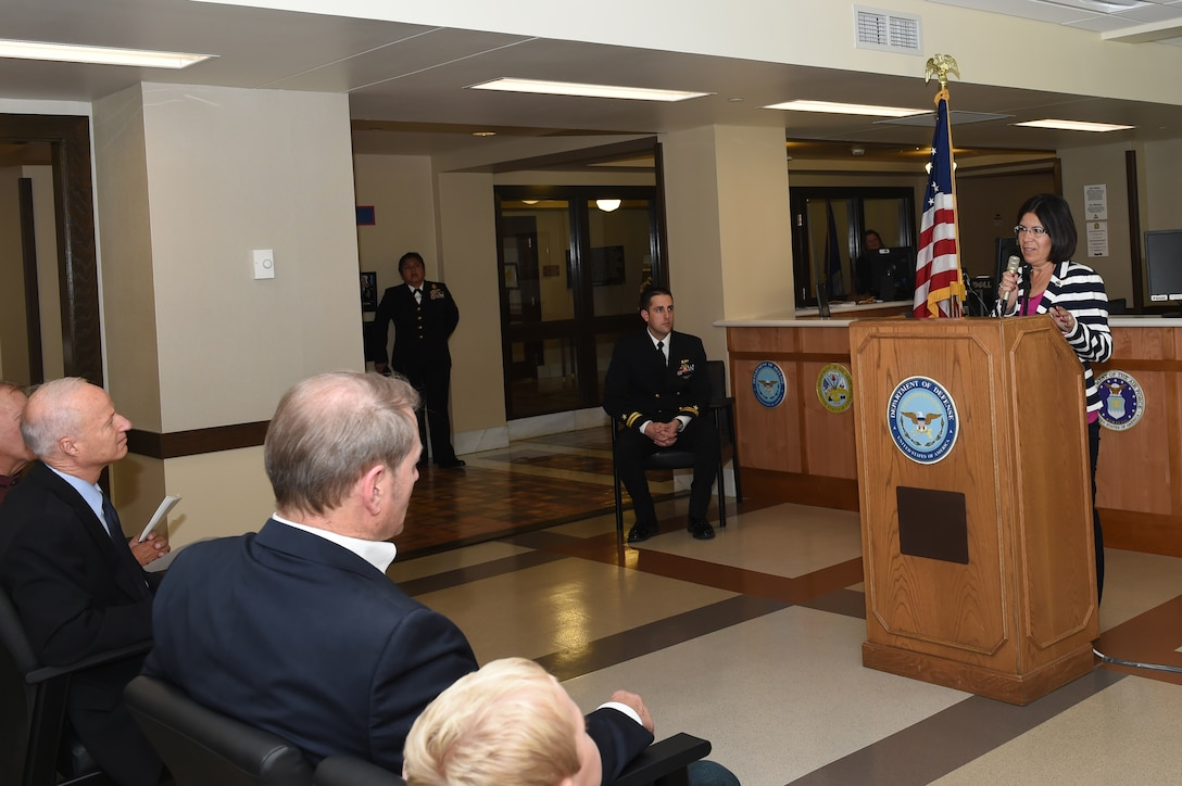 Cindy Dietz speaks during the rededication of the Denver Military Entrance Processing Station ceremony room in honor of her son, Petty Officer 2nd Class Danny Dietz, Navy SEAL, Oct. 14, 2014 at the Denver MEPS along with members from all branches of military service and Denver community members. Danny was part of a four-person Navy SEAL reconnaissance team deployed to Afghanistan during Operation Enduring Freedom. He was killed during the mission. (U.S. Air Force photo by Airman 1st Class Samantha Saulsbury/Released)