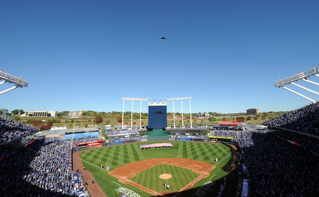 A B-2 Spirit stealth bomber from Whiteman Air Force Base, Mo., flies over the Royals vs. Orioles baseball game at Kauffman Stadium in Kansas City, Mo., Oct. 15, 2014. Airmen from the 509th Bomb Wing and 131st Bomb Wing at Whiteman performed the flag detail and represented the U.S. Air Force to a packed stadium as well as a TV viewership of millions during Game 4 of the American League Championship Series. (U.S. Air Force photo by Airman 1st Class Joel Pfiester/Released)